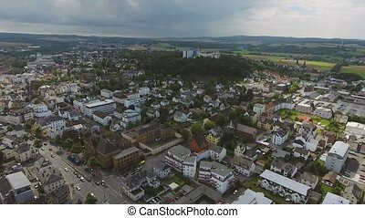 Aerial view of Dutch city with orange historical builidings