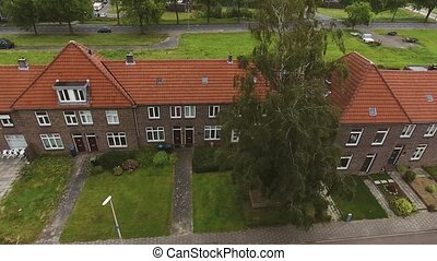 Aerial view of Dutch street with brick houses, cloudy sky....