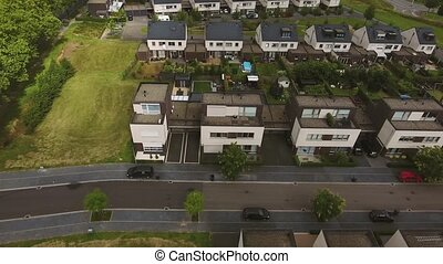 Aerial view of Dutch street with white houses and cars,...
