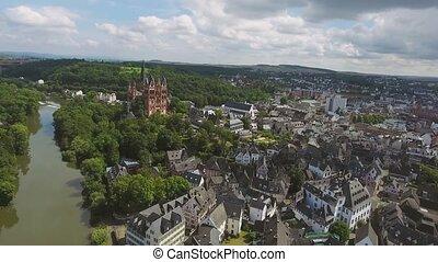 Aerial view of Dutch town; church, river, bridge, white...