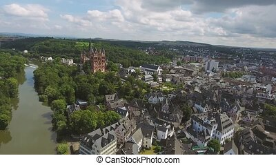 Aerial view of Dutch town; church, river, bridge, white...