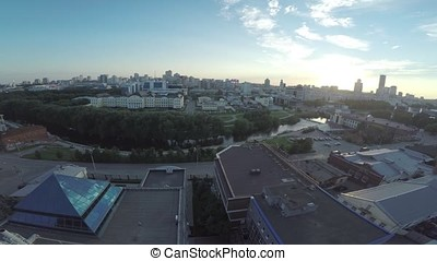 Aerial view of Ekaterinburg city at sunset. Large modern city center viewed from above. Beautiful city aerial view