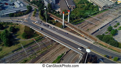 Aerial view of vehicles moving on elevated road on a sunny day 4k