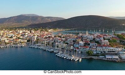 Aerial view of Ermioni old town and marina or seaport, Greece - drone videography. High quality 4k footage