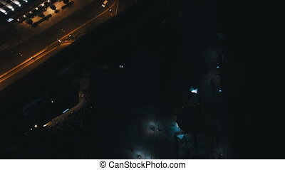 Aerial View of European City at Night with Illuminated Light from Cars, Seafront. Shot in 4K UHD