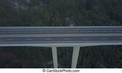 Aerial view of European highway bridge in mountains at dusk