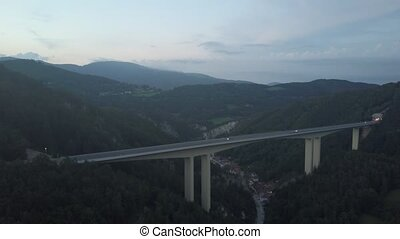 Aerial view of European highway bridge and tunnel in...