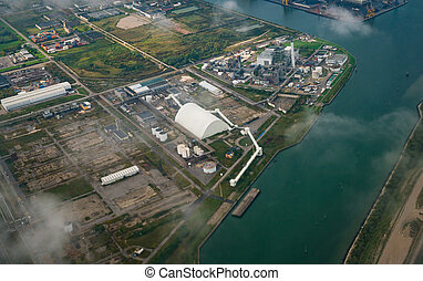 Aerial view of factories in industrial district. Property, ...