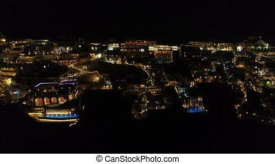 Aerial view of famous Greek resort Thira at night. - Aerial...