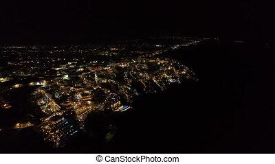 Aerial view of famous Greek resort Thira at night.,...