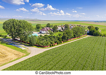 Aerial view of farm buildings and fields