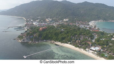 Aerial view of ferry port in tropical country - Aerial drone...