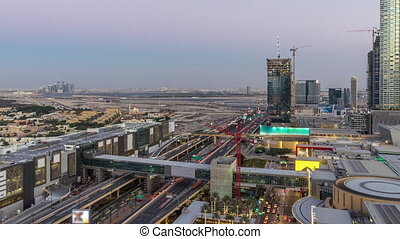 Aerial view of Financial center road day to night timelapse with under construction building