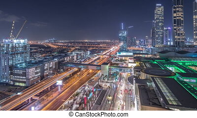 Aerial view of Financial center road night timelapse with under construction building