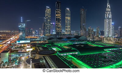 Aerial view of Financial center road night timelapse with under construction buildings