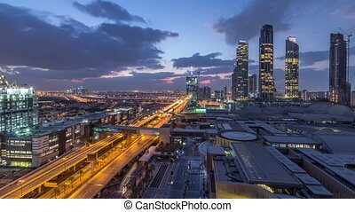 Aerial view of Financial center road night to day timelapse with under construction building