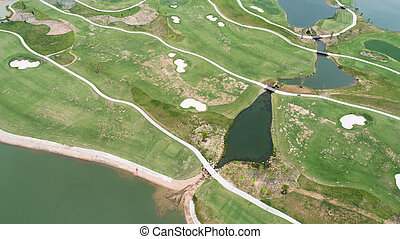 Aerial view of fishing ponds and green fields
