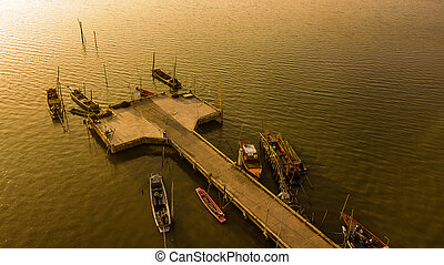 Aerial view of Fishing port in twilight time , Thailand