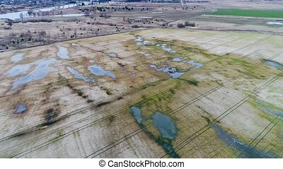 aerial view of flooded fields and lakes at spring
