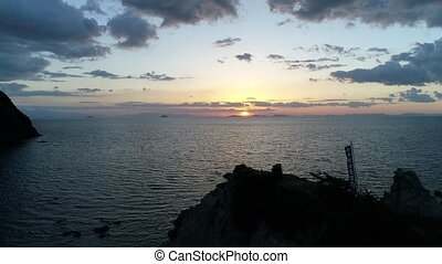 Aerial view of flying drone of sea at sunset sky - Aerial...