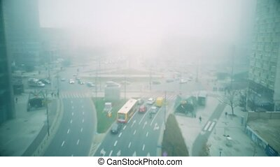 Aerial view of foggy city streets in Warsaw centre, Poland -...