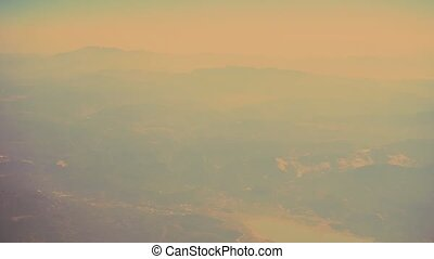 Aerial view of foggy mountains. View from drone or airplane.