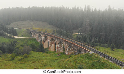 Aerial view of foggy viaduct bridge.