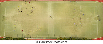 aerial view of football or soccer stadium and sportive people training for match