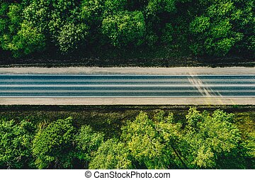 Aerial view of forest country road.