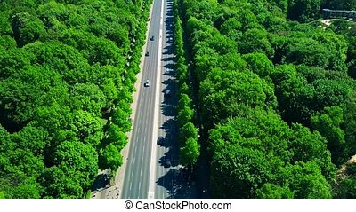 Aerial view of forest highway traffic - Aerial view of...