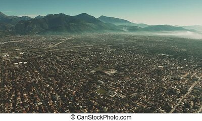Aerial view of Forte dei Marmi and mountains in haze, Italy...