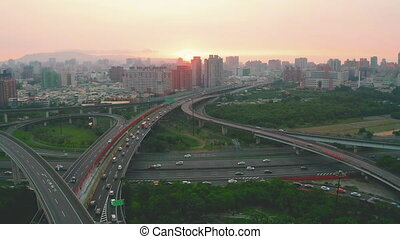 Aerial view of freeway traffic at sunset