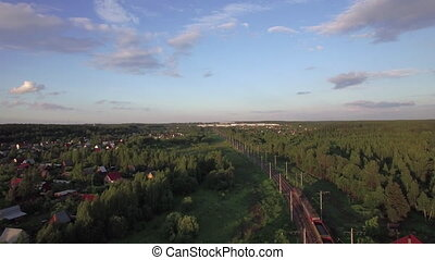 Aerial view of freight train running in the countryside, Russia