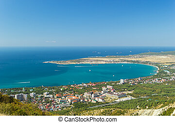 Aerial view of Gelendzhik city and sea bay. Photo of popular resort from hill of caucasian mountains.
