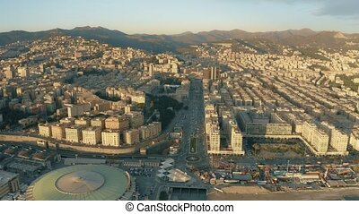 Aerial view of Genoa cityscape and Welcome Genoa Circle in the evening, Italy