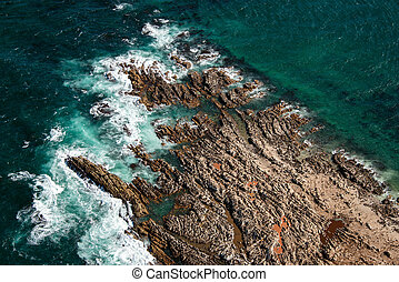 Aerial view of Geyser Rock, a small island next to Dyer Island which is home to a colony of Cape fur seals, off the coast of Gansbaai, South Africa