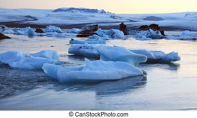 Aerial view of glacier and icebergs in glacier lagoon in...