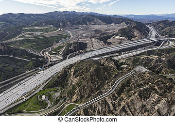 Aerial view of the Golden State 5 Freeway, Los Angeles Aqueduct and Sunshine Canyon Landfill in the Newhall Pass near Santa Clarita, California.
