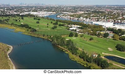 aerial view of golf course, marina, city and ocean 4k -...