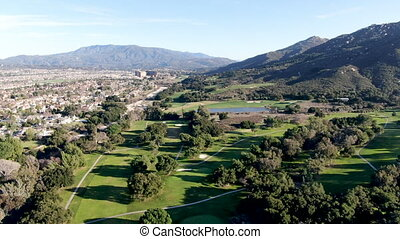 Aerial view of golf course with green field in the valley. Green turf scenery. Temecula, California, USA