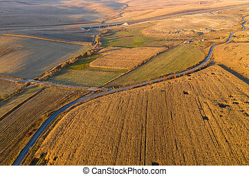 Aerial view of grain fields at sunset