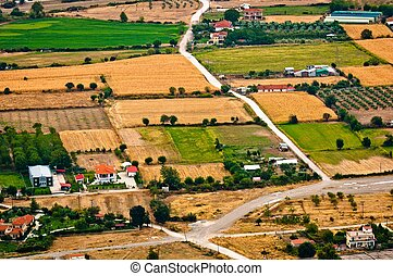 Aerial view of green fields