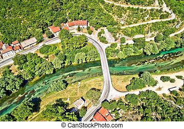 Aerial view of green Krka river bridge in town of Knin, Dalmatia hinterland, Croatia
