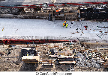 Aerial view of group of workers on construction site, working.
