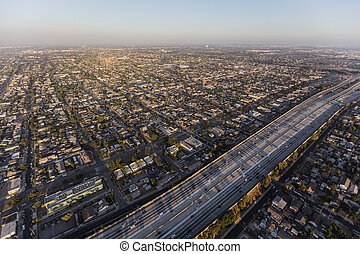 Afternoon aerial of the Harbor 110 freeway in South Los Angeles.