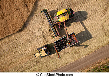 Aerial View of Harvest - Top down view of a harvester...