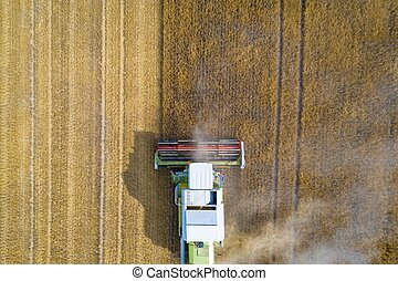 Aerial view of harvester combine working on field