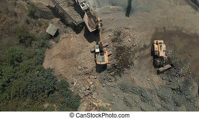 Aerial view of heavy machinery at the quarry.
