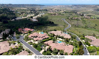 Aerial view of high class neighborhood with big residential mansions with swimming pool in the green valley, Pacific Highlands Ranch, San Diego, California, USA.