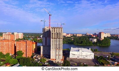 Aerial view of high-rise building under construction at...